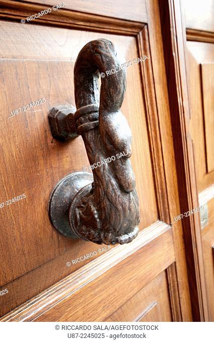 Rusty Door Knocker on an Wooden Gate