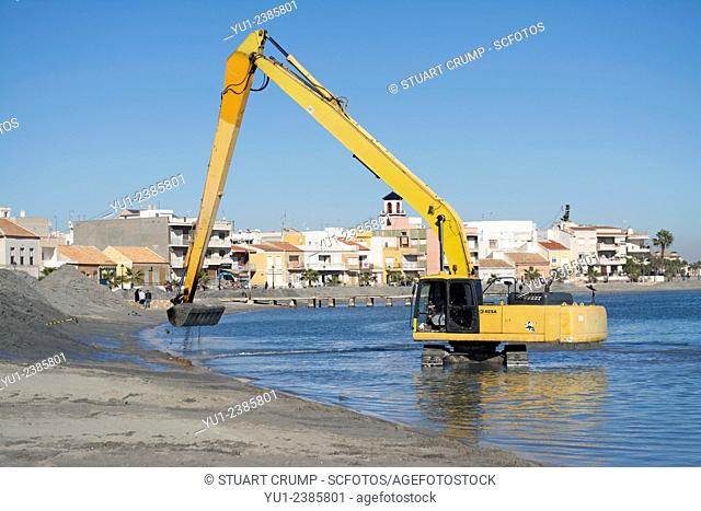 Sand excavation work on the beach at Los Alcazares in Murcia, Spain
