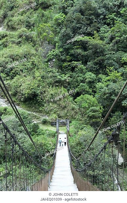 Suspension bridge across Rio Pastaza gorge, Banos, Ecuador