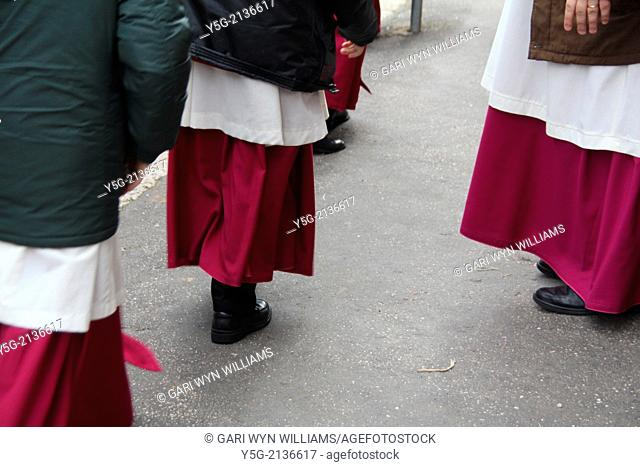 choristers walking in street road in rome italy