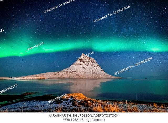 Aurora Borealis or Northern lights with the Milky Way Galaxy over fjord. Mt. Kirkjufell, Grundarfjordur, Snaefellsnes Peninsula, Iceland