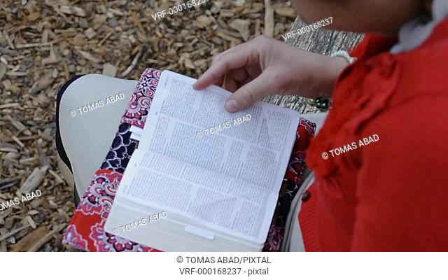 Latino woman reading bible