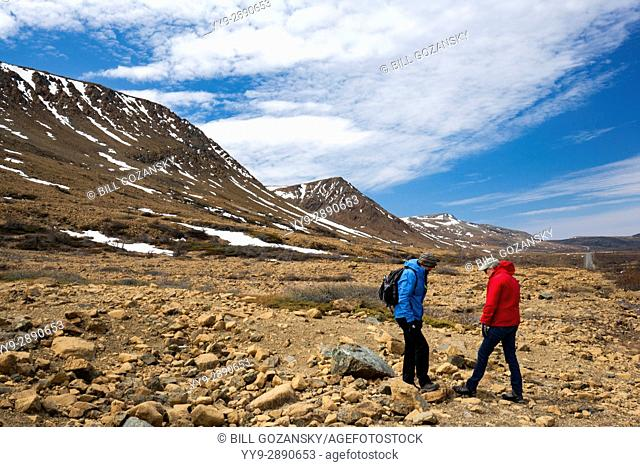 Hikers in the Tablelands, Gros Morne National Park, near Woody Point, Newfoundland, Canada
