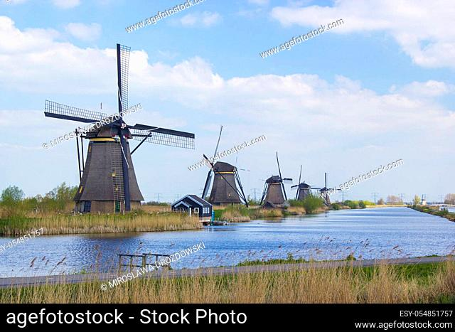 rural landscape with windmills at famous tourist site Kinderdijk in Netherlands. This system of 19 windmills was built around 1740 and is a UNESCO heritage site