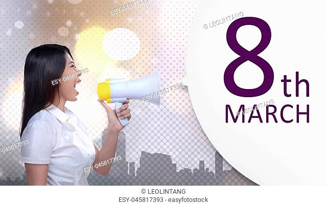 Beautiful asian business woman with megaphone announce 8 March is International Women's Day