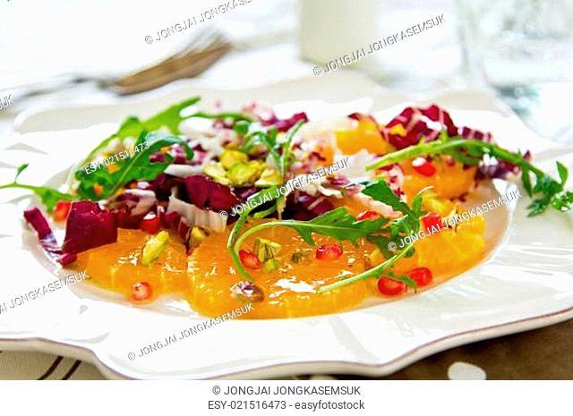 Orange with Radicchio ,Pomegranate and Pistachio salad