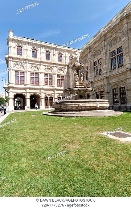 Opera House side garden with fountain depicting the allegorical figures of Music, Dance and Joy , Vienna, Austria