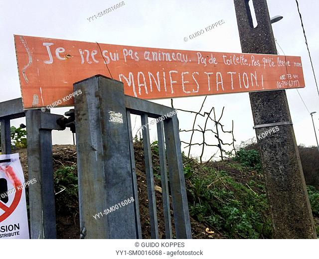 Calais, France. Entrance with shed to migrant camp The Jungle, where refugees bound for the UK have a shelter