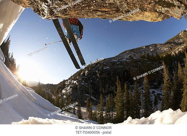 Skier mid jump in Aspen Colorado