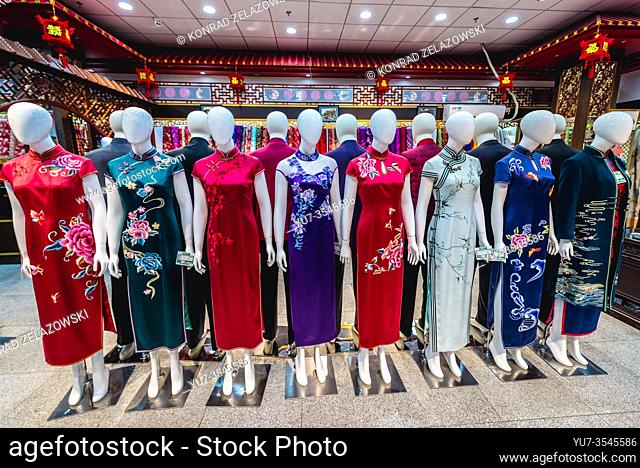 Chinese dresses for sale in shop on Qianmen Street area in Beijing, China