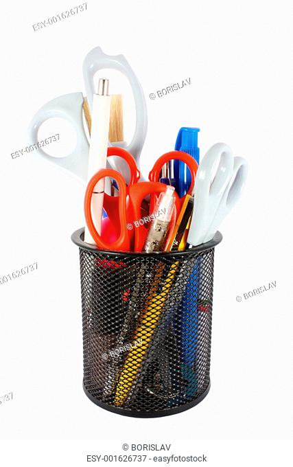 Pencil cup filled with colorful used pens and scissors