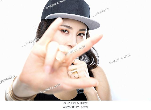 Portrait of young woman in hip-hop style singing