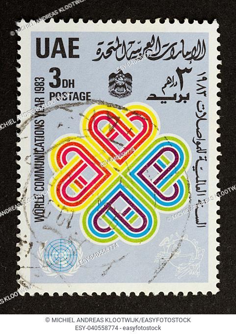 UNITED ARAB EMIRATES - CIRCA 1980: Stamp printed in the UAE shows four hearts, circa 1980