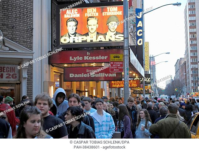 Numerous people stand in line to enter the premiere of the Broadway show 'Orphans' at the Gerald Schoenfeld Theatre in New York, USA, 26 March 2013