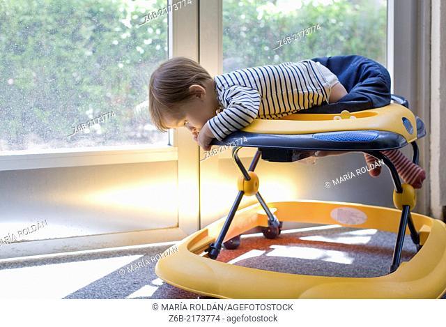 Baby, 10 Months, Walker, Leaning, Mischievous, Risk, Indoors, Door- window, sunlight, garden, Playful