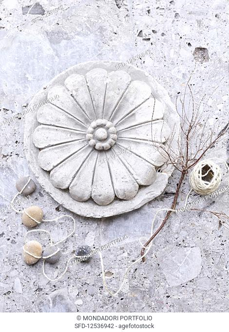 A stone decoration with dried twigs and a ball of string