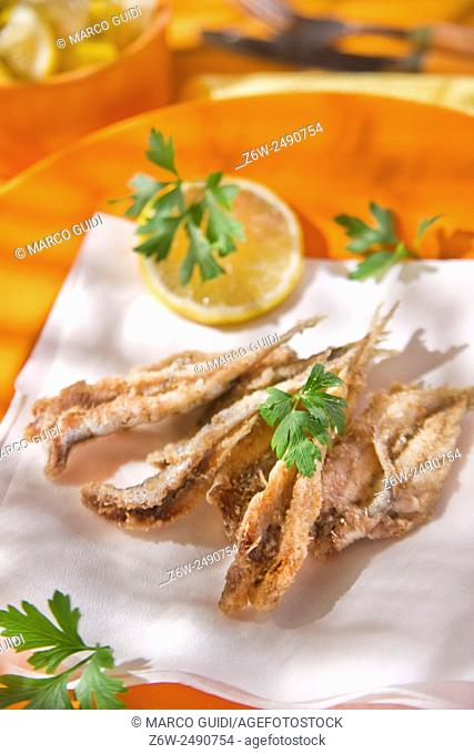 Presentation of a seafood platter, fried anchovies
