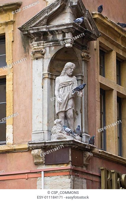statue of jesus with lamb and live doves