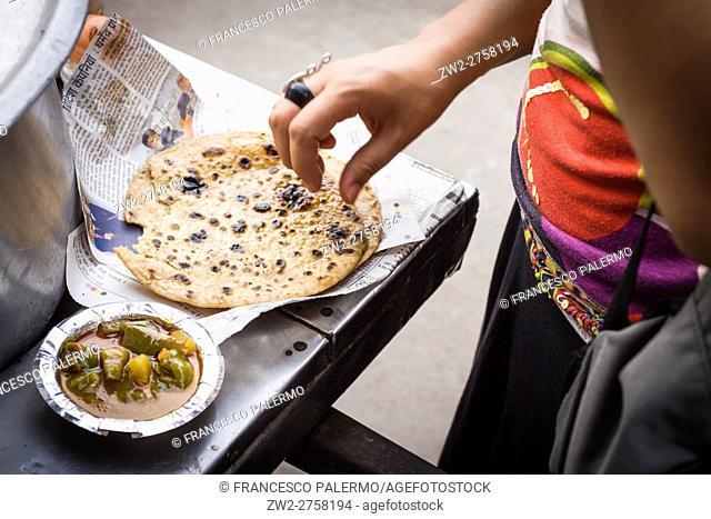 People at the cart street food. New Delhi, Delhi. India