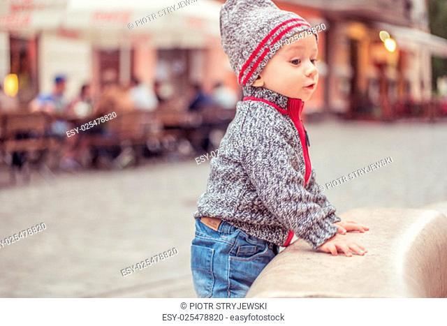 happy little baby boy wearing hat looking up