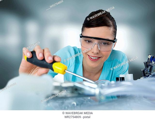 Woman with electronics in blurry grey room