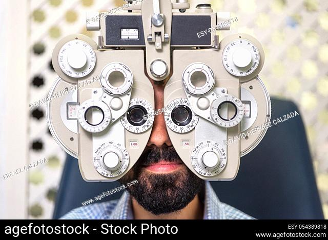 Patient in modern ophthalmology clinic checking the eye vision