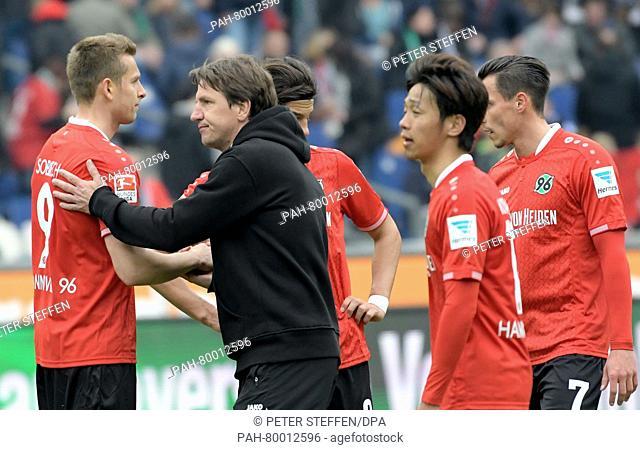 Hannover 96 coach Daniel Stendel (2.f.l) thanks his players after the German Bundesliga game between Hannover 96 vs. FC Schalke 04 in Hanover, Germany