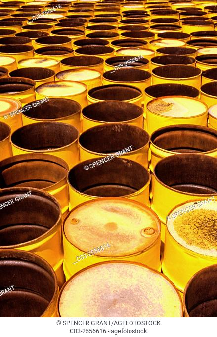 55-gallon yellow oil drums form a pattern on an industrial site in Houston, TX