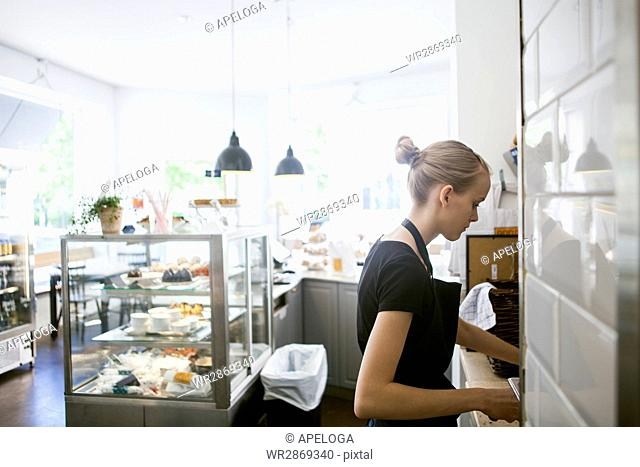 Side view of girl working in restaurant