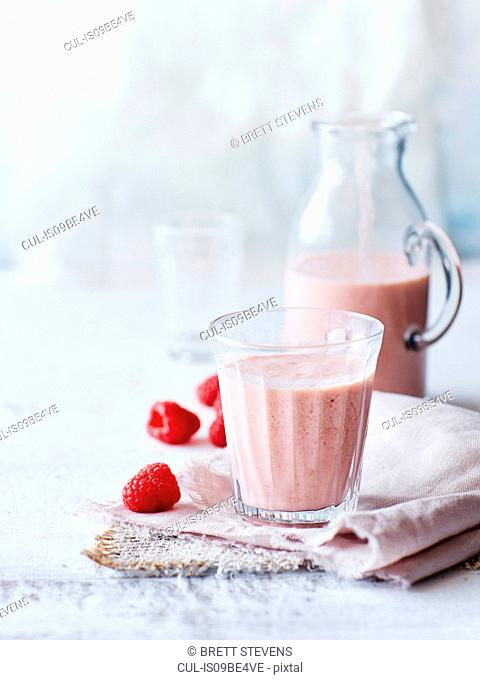 Still life of peach chia raspberry smoothie in glass