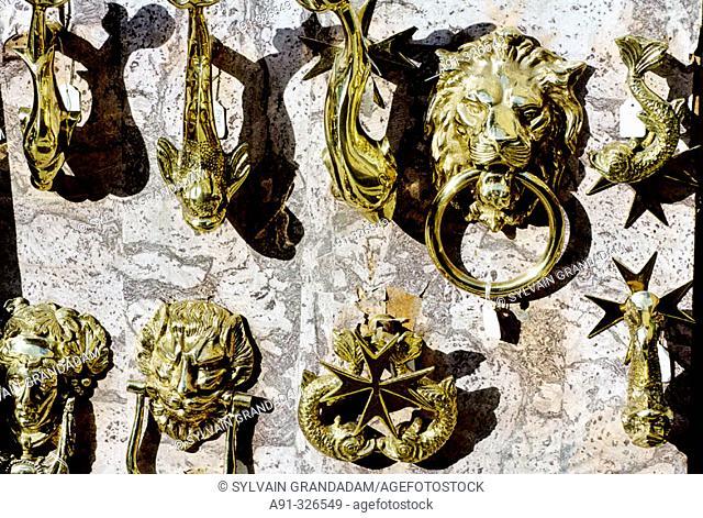 Copper knockers for sale to tourists. Valletta. Malta