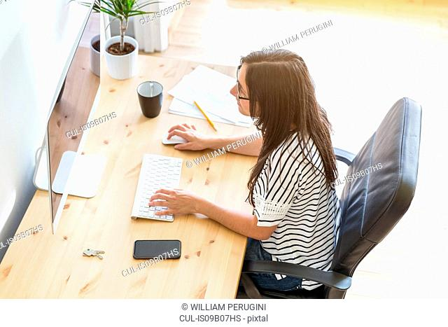 Woman at desk working on computer