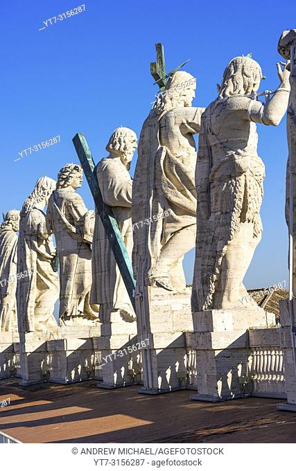 Jesus Christ statue with his 12 disciples at the top of St Peter's Cathedral, Vatican city, Rome, Lazio, Italy