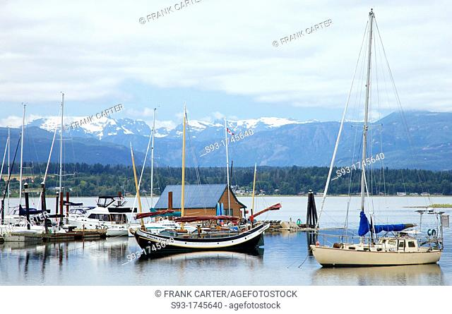 A view of the Comox harbour, with the Comox glacier on the mountains behind