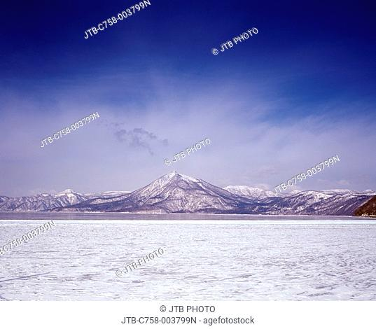 Blue sky Clouds Snow-covered mountain White Winter Lake Shikotsu Mt  Eniwa Chitose Hokkaido Japan