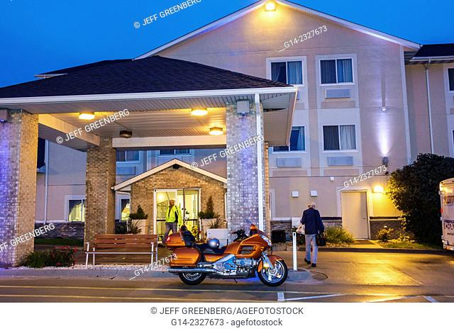 Illinois, Logan County, Lincoln, Holiday Inn Express, hotel, lodging, chain, front, entrance, carport, canopy, motorcycle, parked, dusk, man, guest