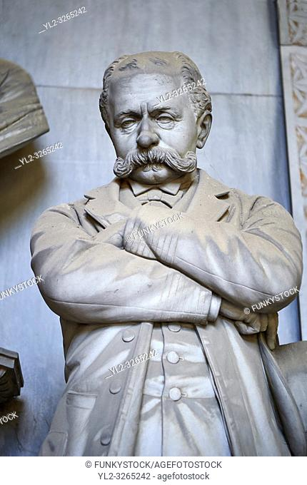 Picture and image of the late borgeoise realistic style stone sculpture of the Gallino tomb sculpted by G. Moreno 1894. In the tomb