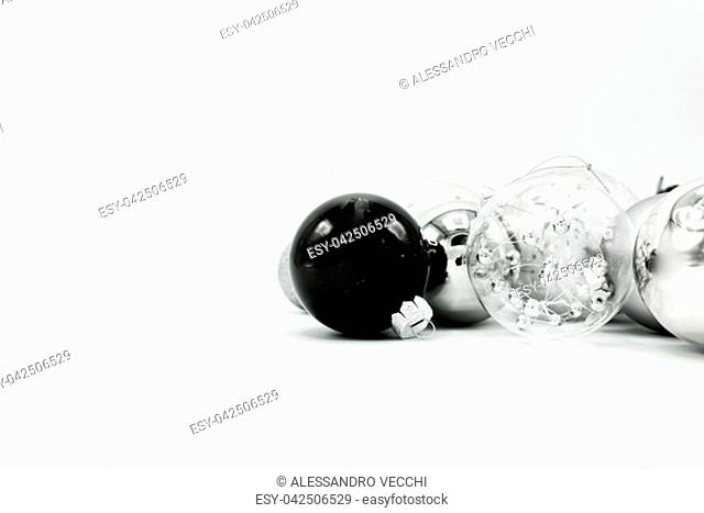 Monochrome elegant Christmas wallpaper background of tree decorations. Classy holidays image in black and white