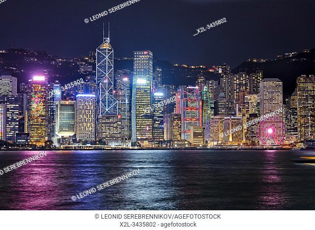 Central Waterfront buildings illuminated at night. Hong Kong, China