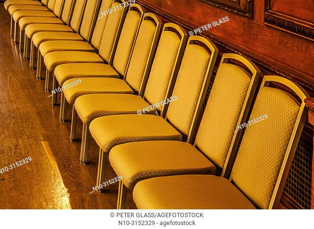 Row of empty chairs in an office building