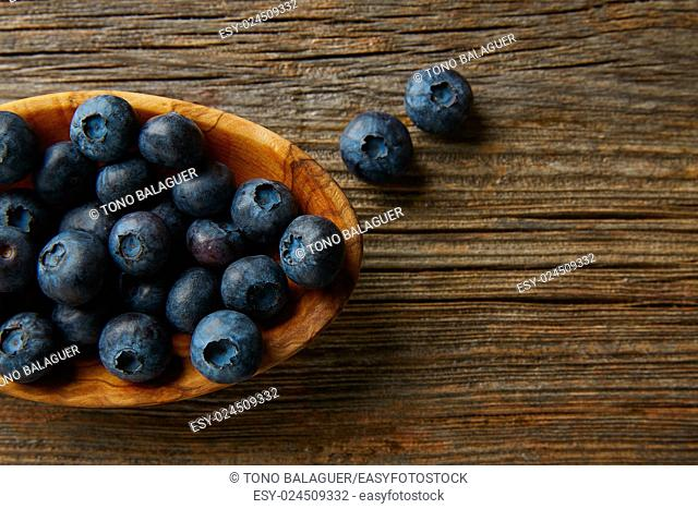Blueberries fruits on a wooden board table background
