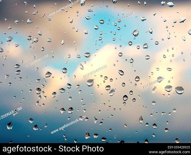 Water drops of rain on blue glass background. Rain drops on window