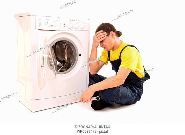 Repairman and washing machine isolated on white background