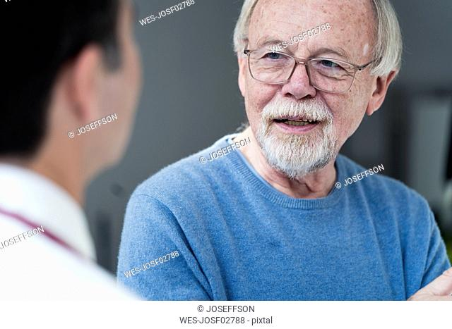 Senior patient talking to doctor in medical practice