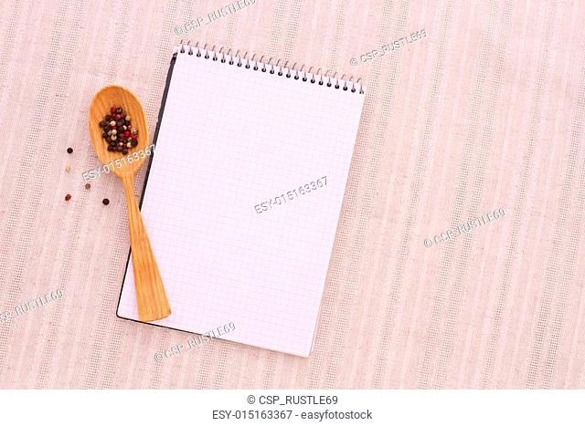 Pure notebook for recording menu, recipe on red checkered tablecloth tartan