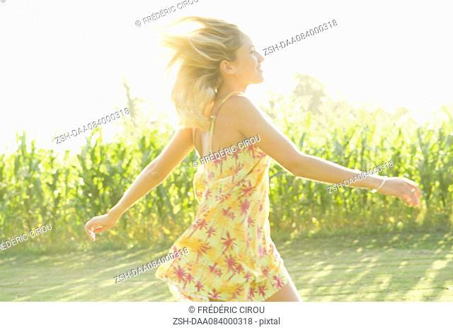 Woman running across open field