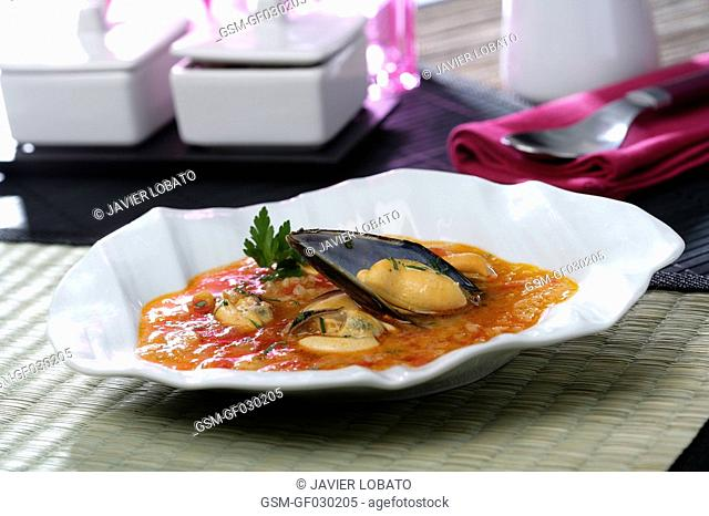 Mussels soup in curly plate