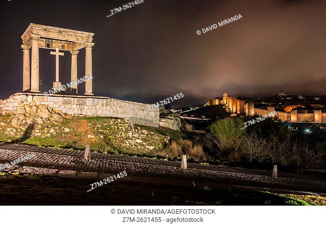 Night view of Medieval City Walls and Cathedral from Los Cuatro Postes, Avila, Castile and Leon, Spain. UNESCO World Heritage Site