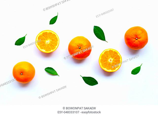 Fresh orange citrus fruits with leaves on white background. Top view