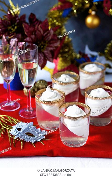 Festive champagne jelly dessert with whipped cream